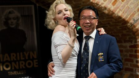 Suzie Kennedy sings with deputy mayor Patrick Chung Picture: KEITH MINDHAM