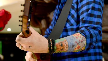 Ed's tattoo of a cat on his arm shown here on his waxwork Picture: IAN WEST/PA WIRE