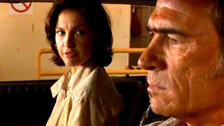 Ashley Judd as the falsely accused murderer Libby Parsons with her parole officer played by Tommy L