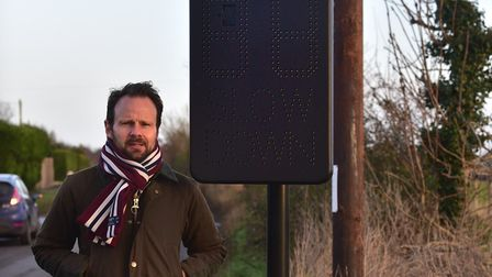 Parish councillor James Mallinder with the device when it was installed last winter Picture: SARAH L
