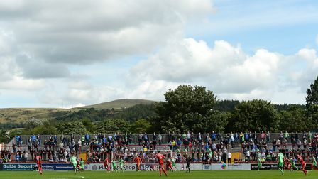 The scene on the opening day of last season, with Colchester United fans in the away end at Accringt