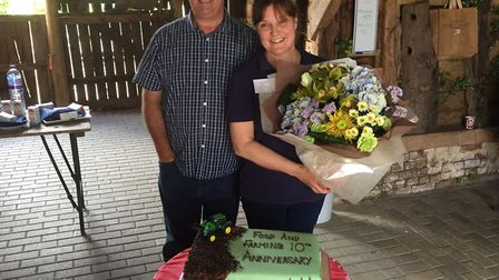 Suffolk Food and Farming Student Day marks 10th year with anniversary cake. Pictured are Robert and