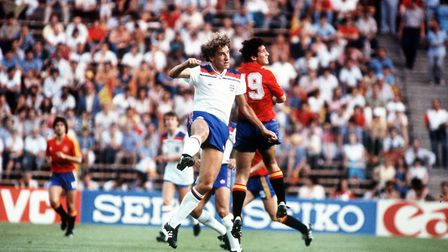 Terry Butcher (left) jumps for the ball during England's match against host nation Spain in 1982. Ph