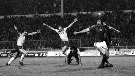 Paul Mariner is on his knees having just scored against Hungary to book England's place at the 1982