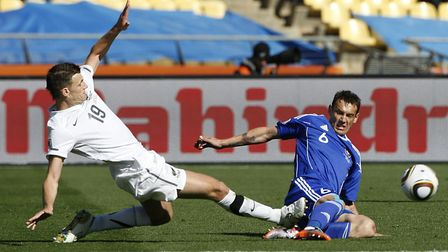 New Zealand's Tommy Smith (left) challenges Slovakia's Zdenko Strba (right) at the 2010 World Cup. P