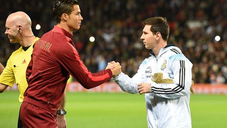 Portugal's Cristiano Ronaldo and Argentina's Lionel Messi shake hands during a friendly in 2014. Pho