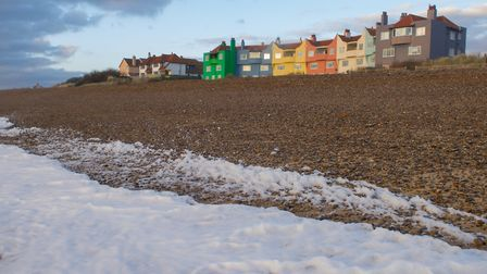 Morning sunlight falls upon the colourful houses on the beach. Picture: SARAH LUCY BROWN
