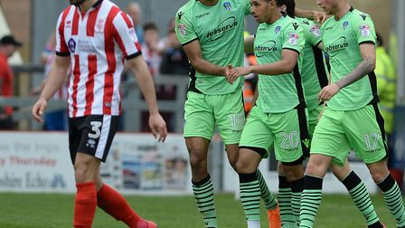 Flashback: Courtney Senior is congratulated on equalising at Lincoln City during the U's penultimate