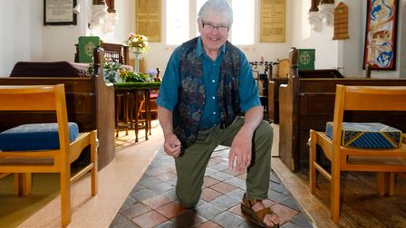 Historian Bill Tamblyn pictured besides the crumbling floor of St Mary the Virgin Church in Peldon P