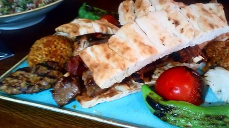 Mixed grill platter, which came with a large bowl of salad and two cold mezze sides Picture: Charlo