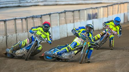 Cameron Heeps (red helmet) tries the outside run on Jan Graversen (white) as the pair battle it out