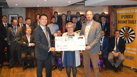 Outgoing chairman Tommy Cheung hands a cheque for �16,534 to Fresh Start - new beginnings CEO David