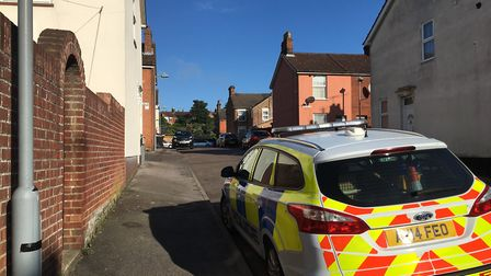 Police cars remain on the scene in Pauline Street this morning Picture: KATY SANDALLS