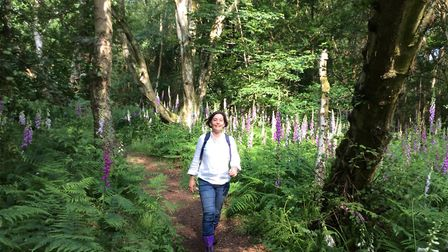 Jane Dow, among the foxgloves and trees of Knettishall Heath. one of the places she leads mindful na