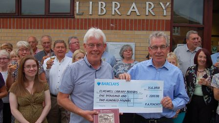 Zoe Clark, (left) Elmswell Library manager with Jimmy Jewell (centre) of Elmswell Library Friends wi