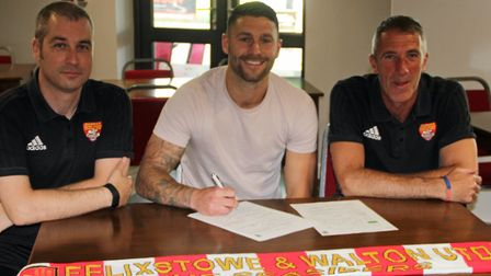 New Seasider: Jack Ainsley, centre, with joint first-team managers Kevin O'Donnell, left and Ian Wat