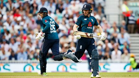 England's Eoin Morgan, (right) and Joe Root, (left) run between the wicket during the One Day Intern