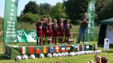 Hardwick School with the winners trophy at the Suffolk Accident Rescue Service football festival Pic