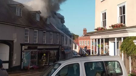 Smoke pours from the buildings Picture: MARK SYMONDS