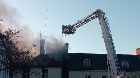 Crews tackle the roof Picture: MARK SYMONDS