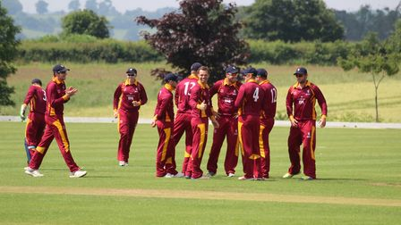 Suffolk celebrate wicket  Tom Rash, centre, gives the thumbs up after taking one of his three early