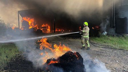 Firefighters tackling a large barn blaze in Toppesfield Picture: ESSEX COUNTY FIRE AND RESCUE SERVIC