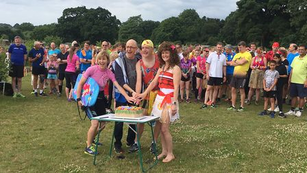 The cutting of the cake to mark the third anniversary of the Brundall parkrun. Picture: CARL MARSTON