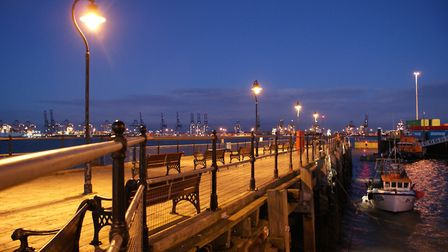 The Ha'penny Pier in Harwich looking out to Felixstowe docks at night. Picture: TDC