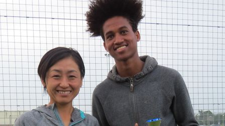 The Colchester Harriers duo of Aiko Henington, left, who was second female, and 17-year-old Ermeas A