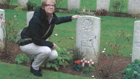 Linda Murrell at the grave of her great uncle Ernest Grommet at the Bellacourt Cemetery, south of Ar