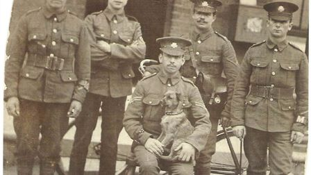 Linda Murrell's great uncle Charles Gromett seated with little dog along with members of his troop