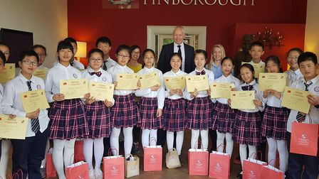 The Chinese exchange students with Finborough headteacher Steven T. Clark Picture: FINBOROUGH SCHOOL