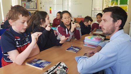 One Chinese student teaching English pupils to count to 10 with one hand Picture: FINBOROUGH SCHOOL