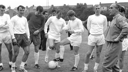 England manager Alf Ramsey (r) prepares to give a team talk as (l-r) John Connelly, Jimmy Greaves, G