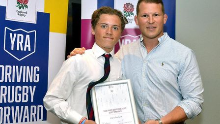 Harry Rowland, left, receives his RFU YRA National awards, receiving a certificate from England capt