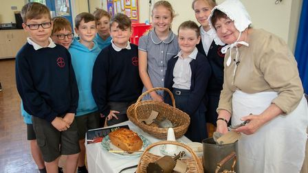 Food historian Monica Askay with children from St Mary's Primary School Picture: DANIEL JONES