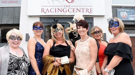 Guests pose before entering the masquerade ball in Newmarket Picture: ROB HOWARTH