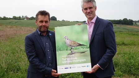 RSPB Suffolk area manager Adam Rowlands presenting James Cartlidge MP with a photo of a turtle dove