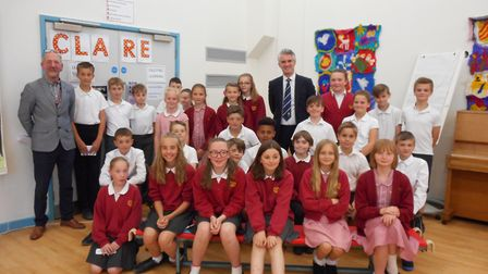 South Suffolk MP James Cartlidge with Year 6 pupils at Clare Community Primary School