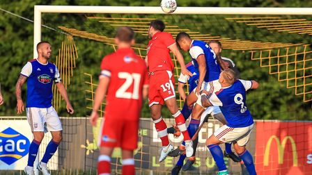 Myles Kenlock heads the danger clear for Town