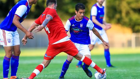 Josh Payne gets his foot to the ball to thwart the efforts of Tristan Nydam in the first half.
