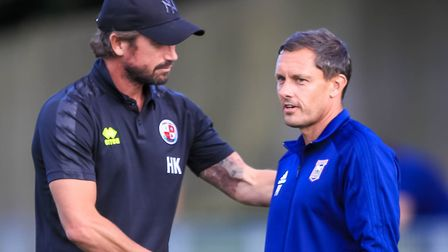 Crawley boss Harry Kewell and Town manager Paul Hurst shake hands ahead of the game last night. Pict