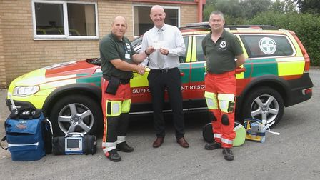 Simon Rolfe from Persimmon Homes Suffolk presents Community Champions funding to SARS volunteer para
