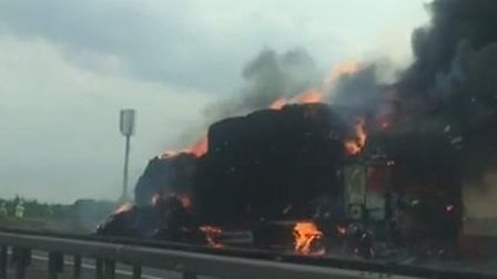 The lorry was carrying 40 tonnes of hay when it caught fire on the M11 Picture: LIAM COLLINS