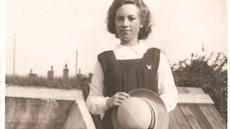 Barbara Root, stood beside one of the old air raid shelters on the site. The picture was taken aroun