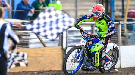 Rory Schlein takes the chequered flag to win heat one against Redcar. Picture: Steve Waller ww