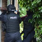 Officers from Suffolk police carry out a drug raid in Ipswich. Picture: KAREN WILLIE
