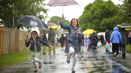Could Suffolk and north Essex see some showers today? Pictured are Grace and Maddie Clarke enjoying