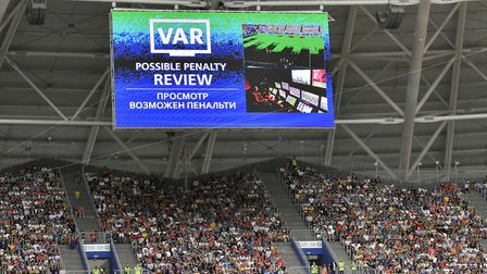 A scree shows a VAR interruption during the group C match between Denmark and Australia Photo: PA