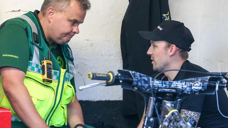 Paramedic Jason Gillingham, with Danny King after the Witches skipper pulled out of the Edinburgh cl